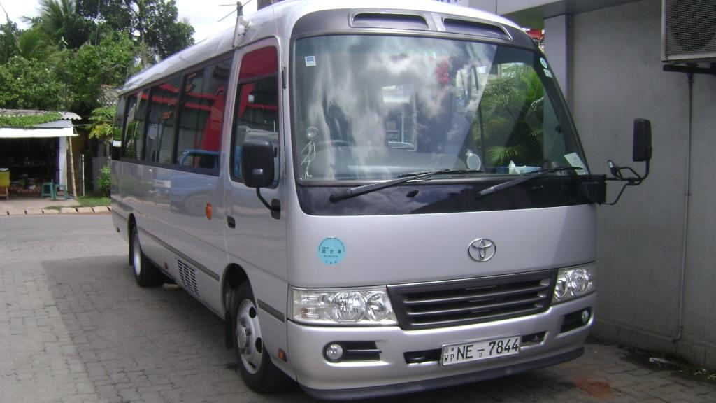 Toyota coaster mini coach 29 seater for hire